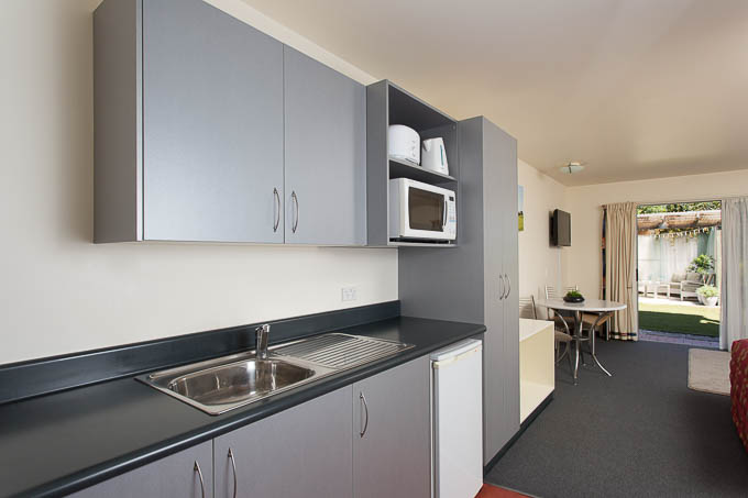 A professional photo showing the kitchen facilities at a Nelson motel