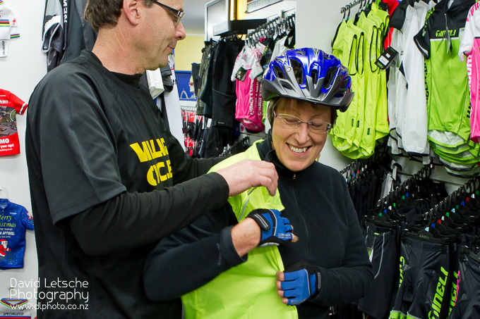 Lady trying on cycle gear at Village Cycles.